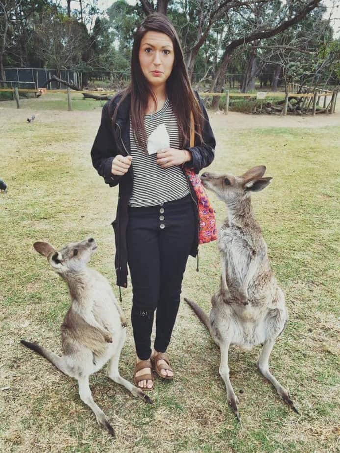 Girls Who Travel | Featured Member Ruthie poses with 2 kangaroos