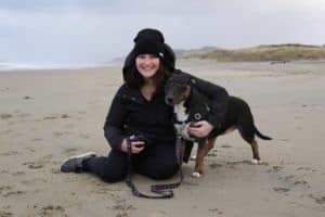 Girls Who Travel   Team Member Priscilla poses on the beach with her dog