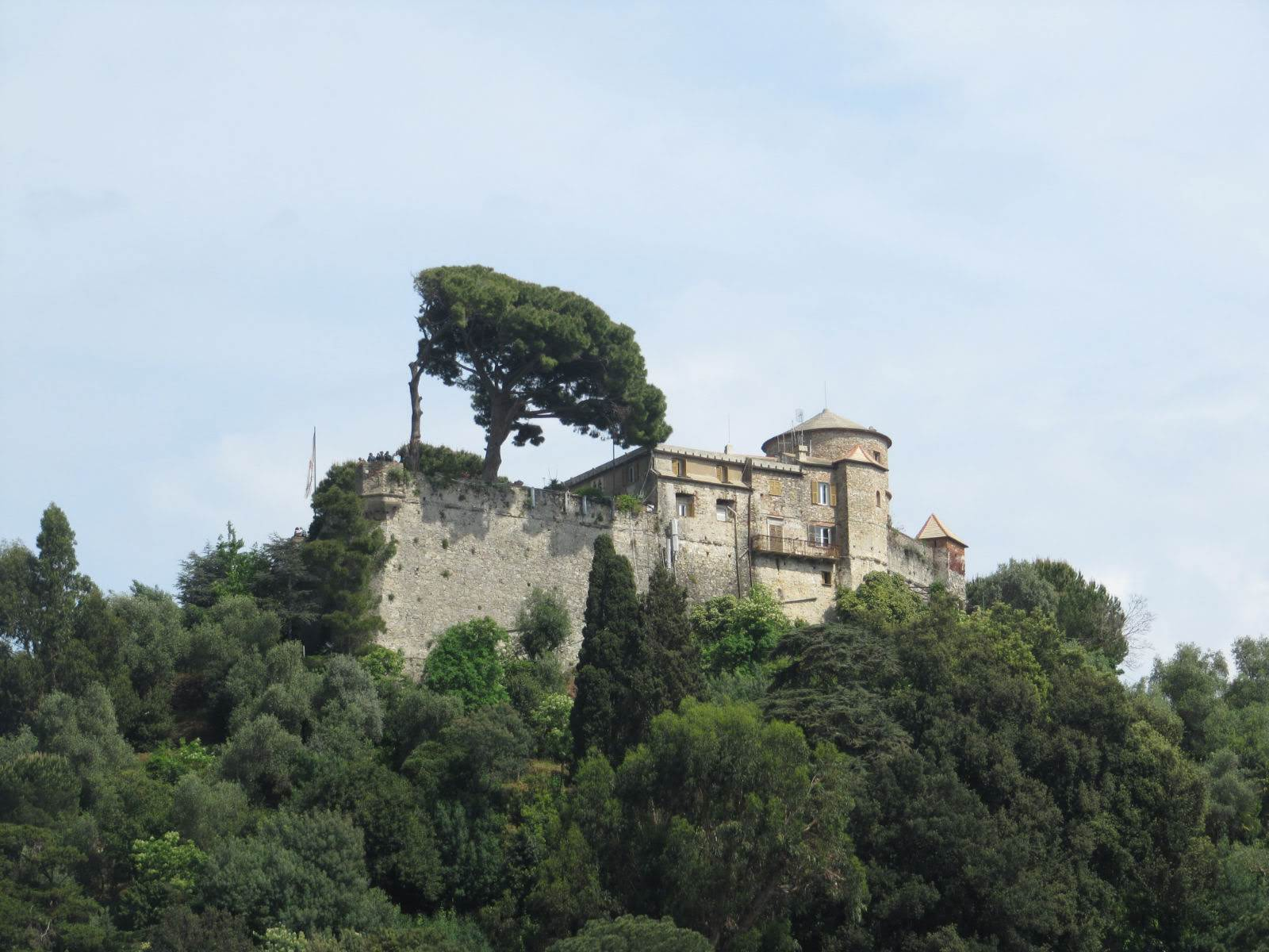 Girls Who Travel | A stone castle at the top of a wooded hill