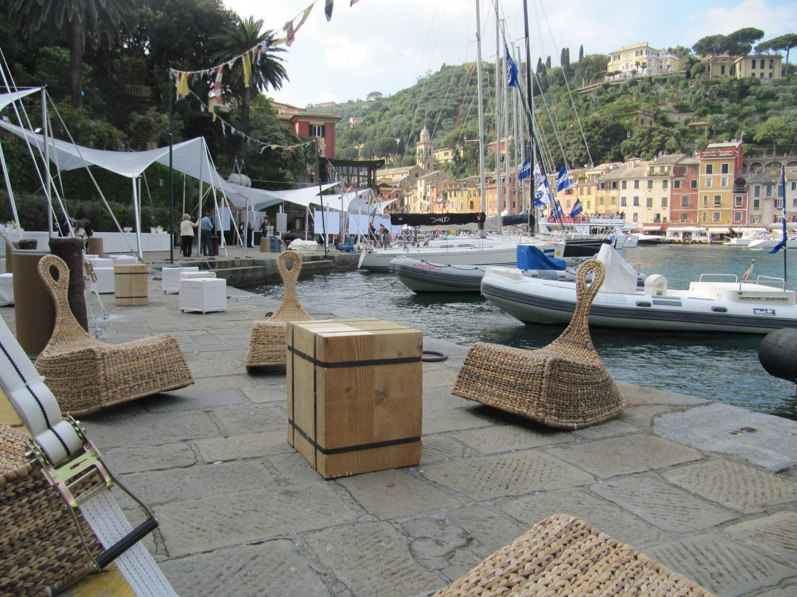 Girls Who Travel | Lounge seating beside the docks in the Portofino harbor