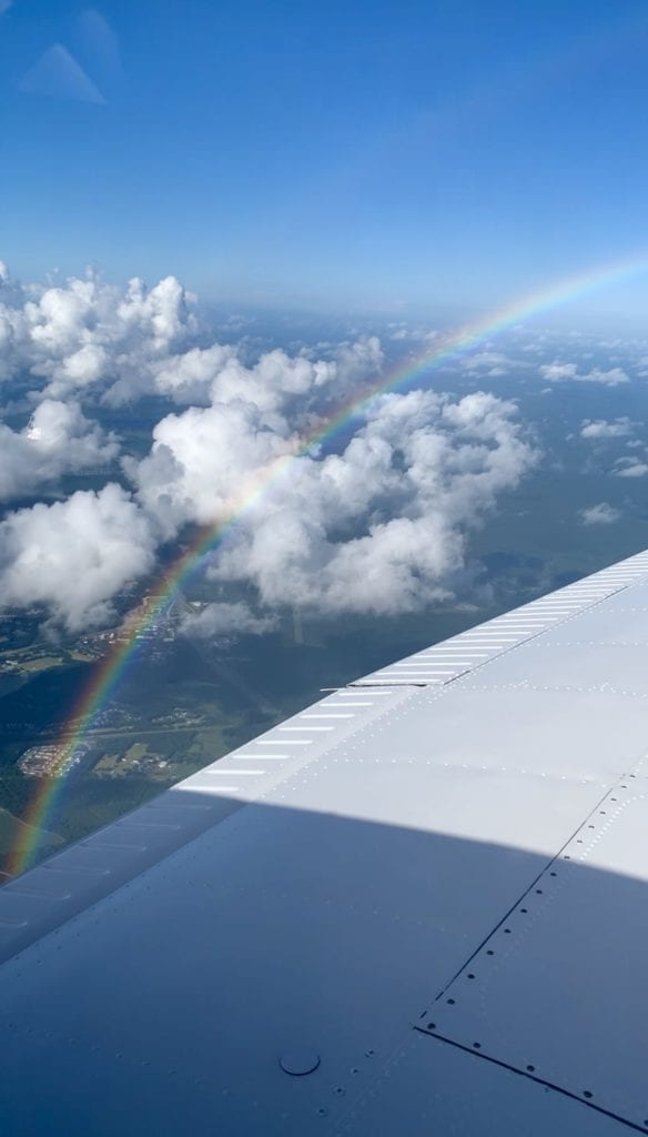 Girls Who Travel   Rainbow from the air