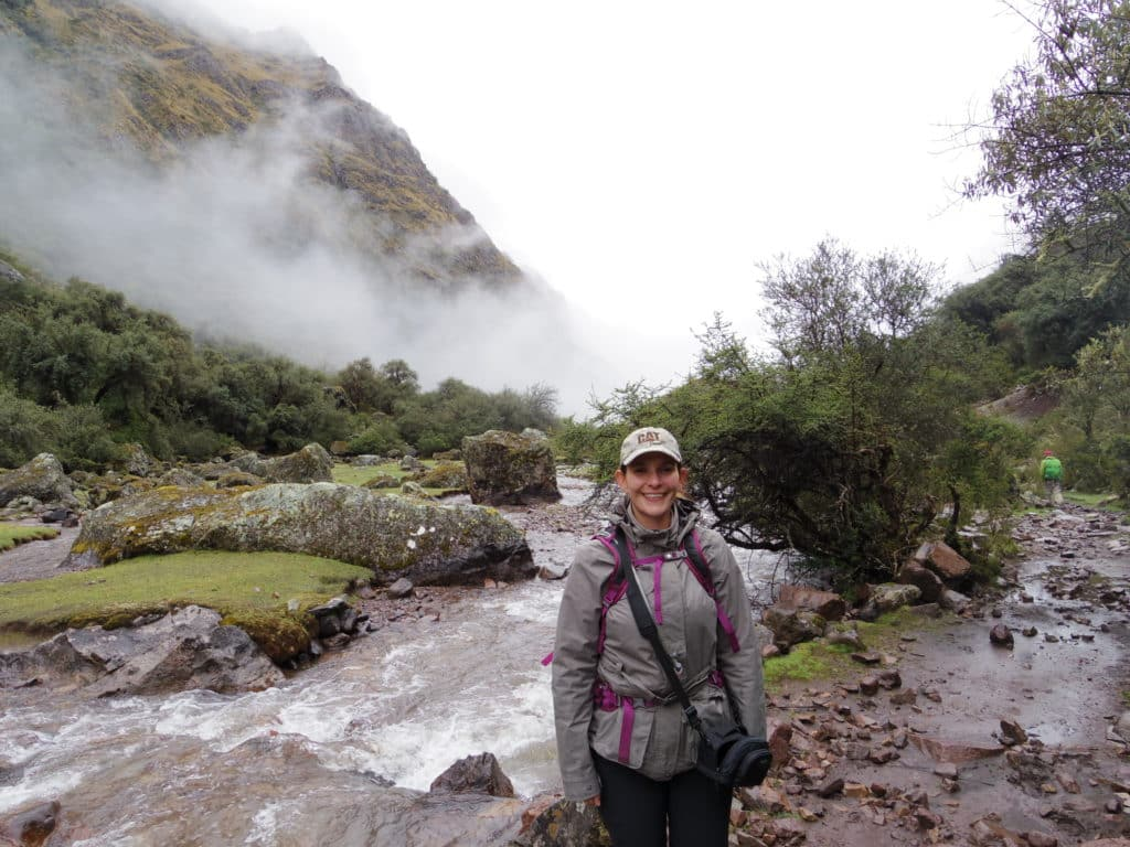 Jenny poses in the fog in the mountains on part of their hiking adventures