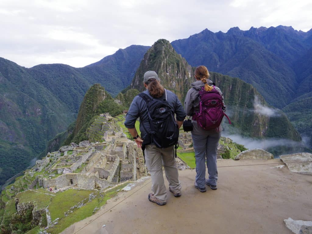 Jenny and TJ have their backs to the camera while they admire the site of Machu Picchu