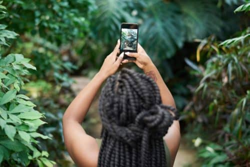 Her Adventures | Girl taking pictures using smartphone