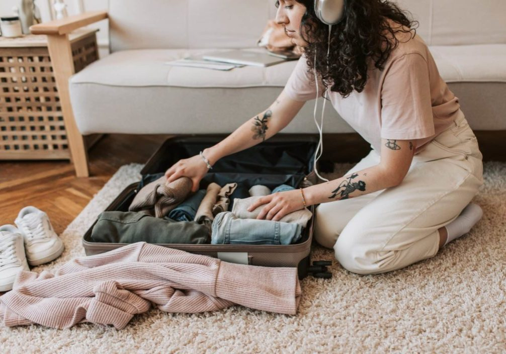 Girls Who Travel   Woman Packing Suitcase